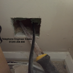 pull telephone cable into new hole